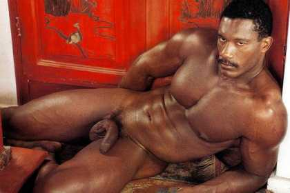 Smouldering man lying by Chinese cabinet