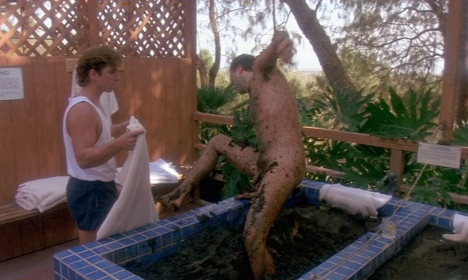 Tim Robbins climbs from a mud bath in The Player