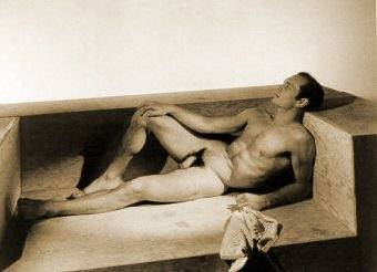 Yul Brynner on hard wooden sofa